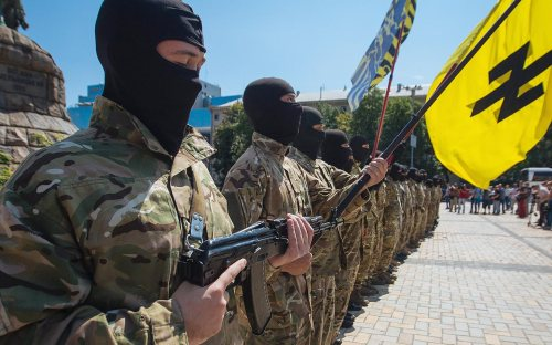 epa04318197 New soldiers of Ukrainian army battalion 'Azov' attend their oath of allegiance ceremony before departing to eastern Ukraine in Kiev, Ukraine, 16 July 2014. The government in Kiev does not recognize the declared independence of the Donetsk and Luhansk regions, and pro-Russian militants refuse to cooperate with the pro-European leadership in Kiev. Ukraine insisted that there would be no ceasefire or negotiations before the pro-Russian separatists in the country's east give up their arms.  EPA/ROMAN PILIPEY